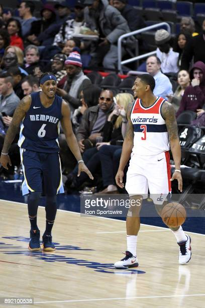 Washington Wizards guard Bradley Beal shares a laugh with Memphis Grizzlies guard Mario Chalmers as time winds down on December 13 2017 at the...