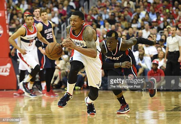 Washington Wizards guard Bradley Beal steals the ball from Atlanta Hawks guard Dennis Schroder in the fourth quarter during game four of the NBA...