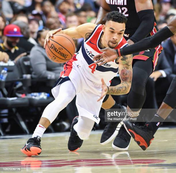 Washington Wizards guard Chris Chiozza works the ball against the Miami Heat at Capital One Arena