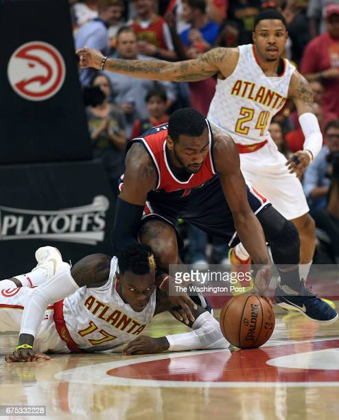 ATLANTA GA APRIL Washington Wizards guard John Wall beats Atlanta Hawks guard Dennis Schroder to a loose ball during the second half of Game Six of...