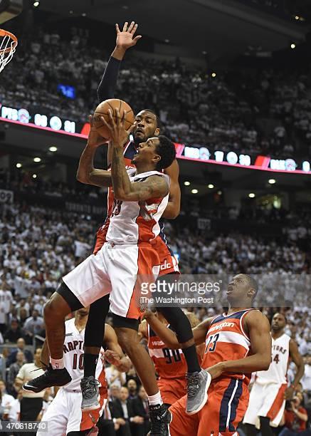 Washington Wizards guard John Wall blocks a shot by Toronto Raptors guard Louis Williams during game two action on April 21 2015 in Toronto Ontario