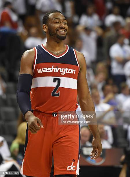 Washington Wizards guard John Wall breaks a smile as time runs out on their overtime win over the Toronto Raptors during game one action on April 18...