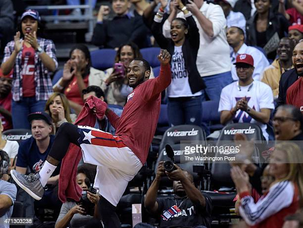 Washington Wizards guard John Wall celebrates after a Washington Wizards basket late in the second half of Game 4 of the Eastern Conference...
