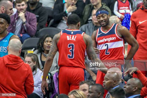 Washington Wizards guard John Wall celebrates with guard Bradley Beal following their game on March 31 2018 at the Capital One Arena in Washington DC...