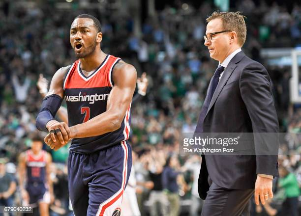 Washington Wizards guard John Wall complains that he was fouled by Boston Celtics guard Avery Bradley as he stole the ball during overtime in game...
