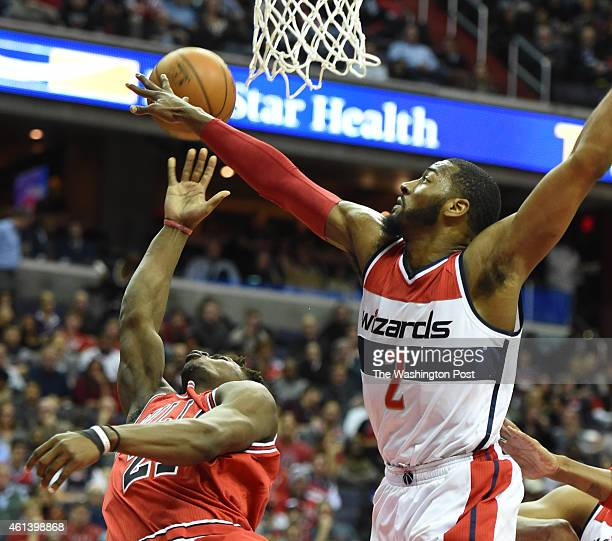 Washington Wizards guard John Wall contests a shot by Chicago Bulls guard Jimmy Butler on January 9 2015 in Washington DC