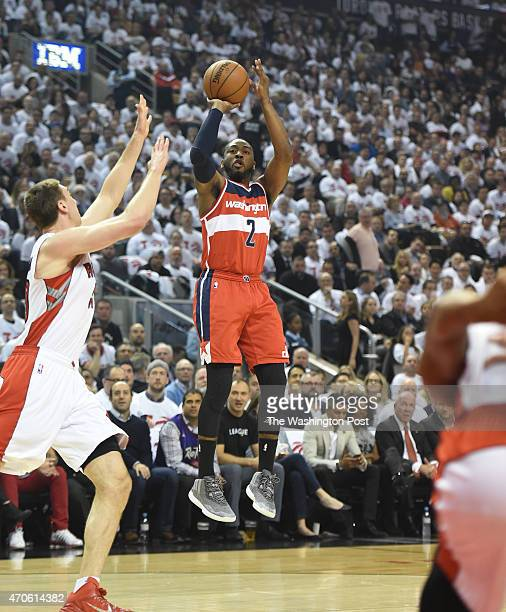 Washington Wizards guard John Wall drains a midrange jumper against the Toronto Raptors during game two action on April 21 2015 in Toronto Ontario
