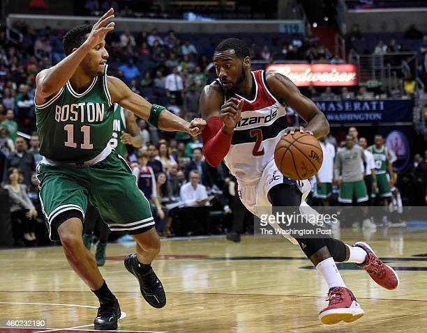 Washington Wizards guard John Wall drives past Boston Celtics guard Evan Turner during the second overtime of the game between the Washington Wizards...
