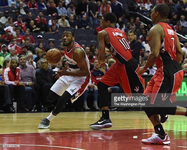Washington Wizards guard John Wall drives to the basket past Toronto Raptors guard DeMar DeRozan in the first quarter during game four action on...