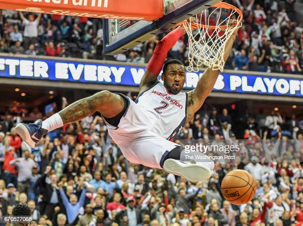 Washington Wizards guard John Wall dunks against the Atlanta Hawks during the Game two of the Eastern Conference Quarterfinals in Washington DC on...
