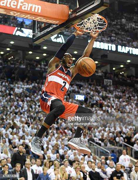 Washington Wizards guard John Wall dunks during their first half run against the Toronto Raptors during game two action on April 21 2015 in Toronto...