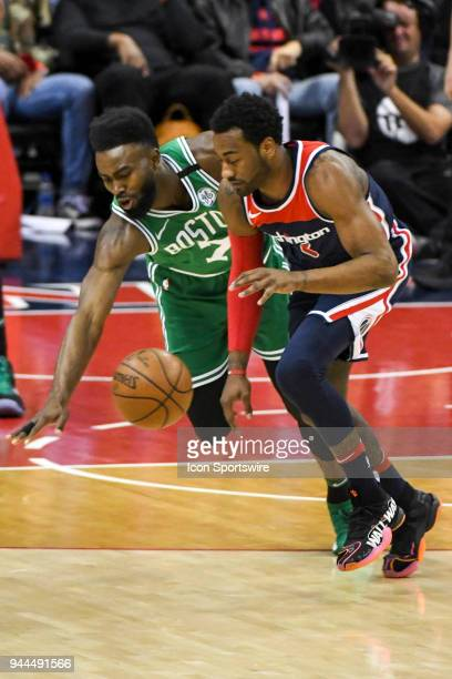 Washington Wizards guard John Wall fights for control of the ball with Boston Celtics guard Jaylen Brown on April 10 2018 at the Capital One Arena in...