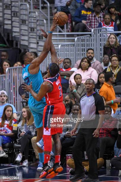 Washington Wizards guard John Wall fouls Charlotte Hornets center Dwight Howard in the second half on March 31 2018 at the Capital One Arena in...