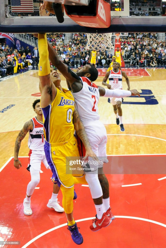 Washington Wizards guard John Wall (2) fouls Los Angeles Lakers forward Kyle Kuzma (0) on a fast break in the second half in action on November 9, 2017 at the Capital One Arena in Washington, D.C. The Washington Wizards defeated the Los Angeles Lakers, 111-95.