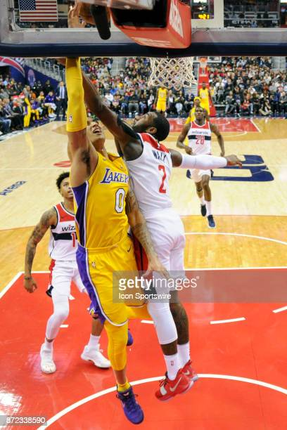 Washington Wizards guard John Wall fouls Los Angeles Lakers forward Kyle Kuzma on a fast break in the second half in action on November 9 2017 at the...