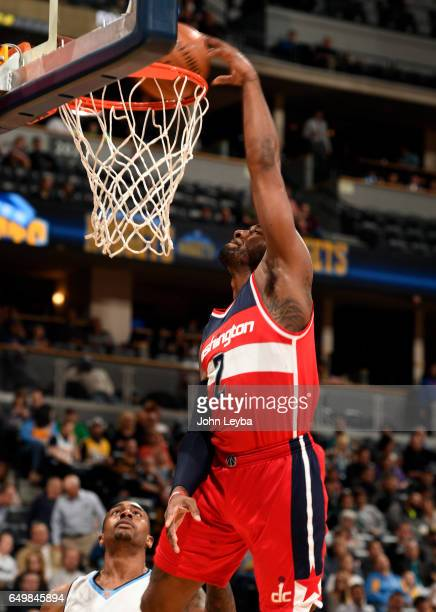 Washington Wizards guard John Wall gets an easy dunk against the Denver Nuggets during the third quarter on March 8 2017 in Denver Colorado at Pepsi...