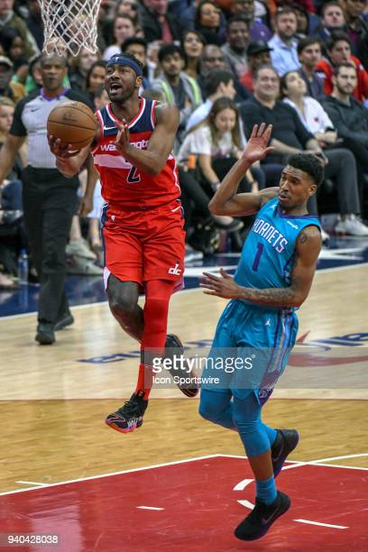 Washington Wizards guard John Wall goes to the basket and scores in the second half against Charlotte Hornets guard Malik Monk on March 31 2018 at...