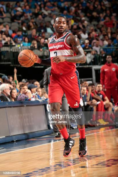 Washington Wizards guard John Wall handles the ball during the game against the Dallas Mavericks on October 6 2018 at the American Airlines Center in...