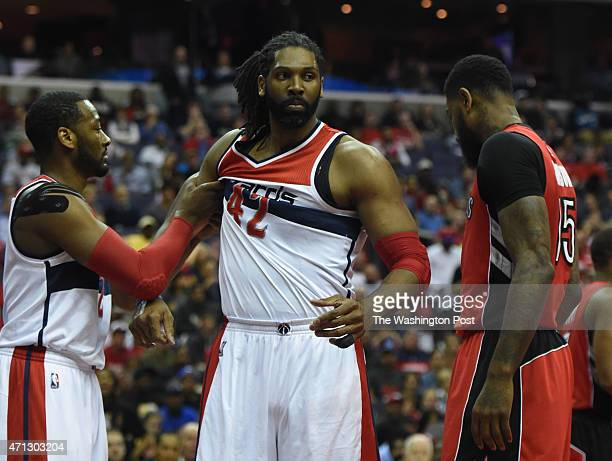 Washington Wizards guard John Wall holds back Washington Wizards forward Nene Hilario in the first quarter against the Toronto Raptors during game...