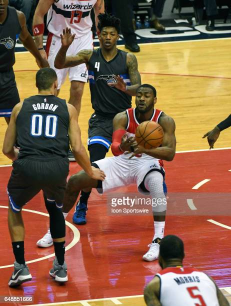 Washington Wizards guard John Wall makes a pass under the basket in the first half against Orlando Magic forward Aaron Gordon on March 5 at the...