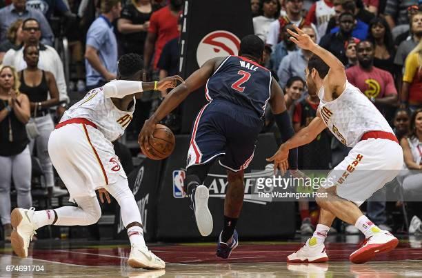 ATLANTA GA APRIL Washington Wizards guard John Wall runs between Atlanta Hawks guard Dennis Schroder left and Atlanta Hawks guard Jose Calderon right...