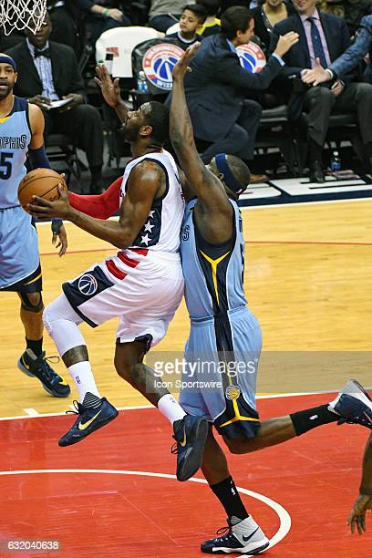 Washington Wizards guard John Wall scores and is fouled by Memphis Grizzlies forward Zach Randolph in the first half on January 18 at the Verizon...