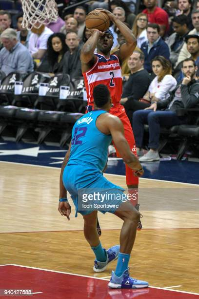 Washington Wizards guard John Wall scores in the first half against Charlotte Hornets center Dwight Howard on March 31 2018 at the Capital One Arena...