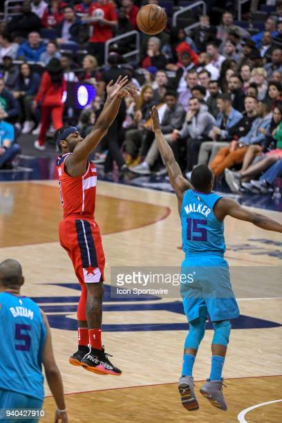 Washington Wizards guard John Wall scores over Charlotte Hornets guard Kemba Walker in the first half on March 31 2018 at the Capital One Arena in...