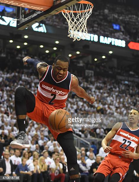 Washington Wizards guard John Wall screams after dunking during game two action against the Toronto Raptors on April 21 2015 in Toronto Ontario