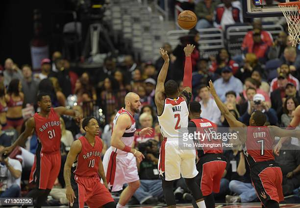 Washington Wizards guard John Wall shoots a jumper during the first half of Game 4 of the Eastern Conference Quarterfinals between the Washington...