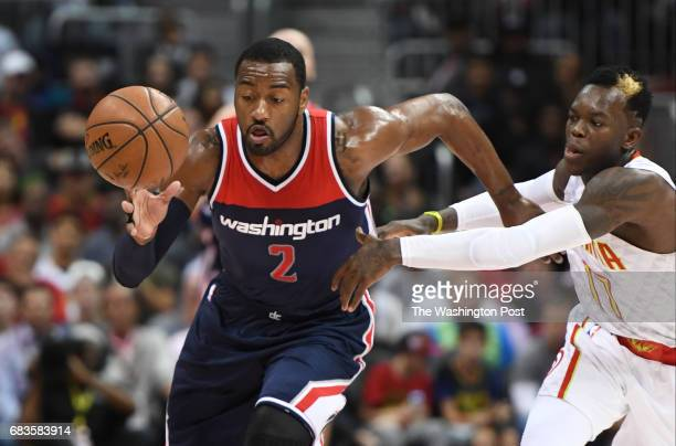 Washington Wizards guard John Wall steals the ball from Atlanta Hawks guard Dennis Schroder during the Game four of the Eastern Conference...