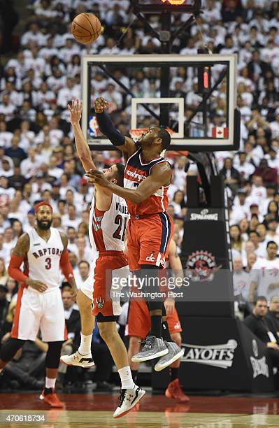 Washington Wizards guard John Wall steals the ball from Toronto Raptors guard Greivis Vasquez during game two action on April 21 2015 in Toronto...