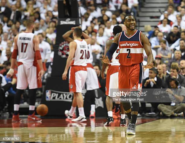 Washington Wizards guard John Wall tells the bench to calm down during a little run during the 4th period against the Toronto Raptors during game two...