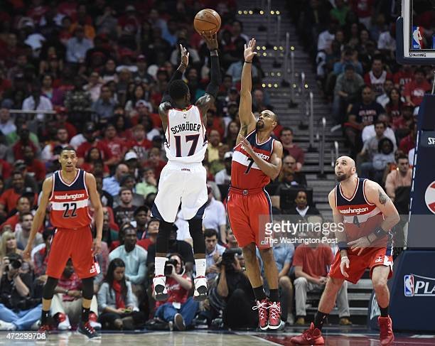 Washington Wizards guard Ramon Sessions contests a jumper by Atlanta Hawks guard Dennis Schroder during game two of the NBA Eastern Conference...