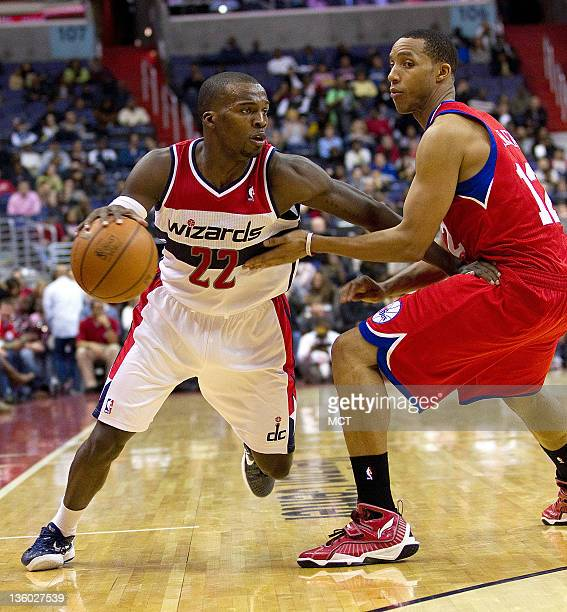 Washington Wizards guard Shelvin Mack drives against Philadelphia 76ers shooting guard Evan Turner during their NBA preseason game played at the...