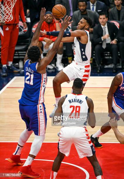 Washington Wizards guard Troy Brown Jr goes the basket against Philadelphia 76ers center Joel Embiid on December 5 2019 at the Capital One Arena in...