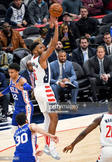 Washington Wizards guard Troy Brown Jr shoots against Philadelphia 76ers guard Matisse Thybulle on December 5 2019 at the Capital One Arena in...