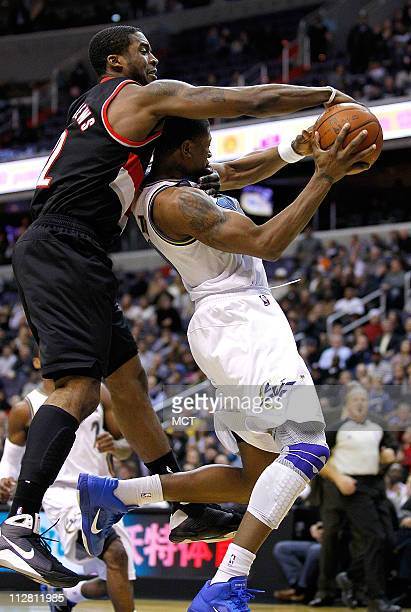 Washington Wizards guard/forward Cartier Martin is fouled by Portland Trail Blazers guard Wesley Matthews during their game played at the Verizon...