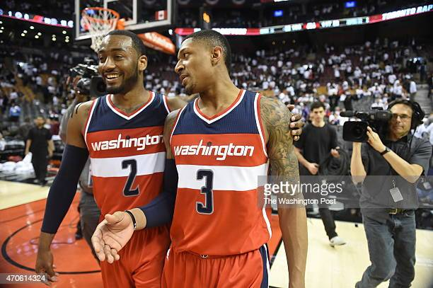 Washington Wizards guards John Wall and Bradley Beal leaves the court after their win over the Toronto Raptors in game two on April 21 2015 in...