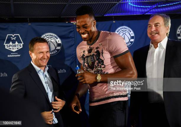 Washington Wizards head coach Scott Brooks new center Dwight Howard and General Manager Ernie Grunfeld laugh after a press conference introducing...