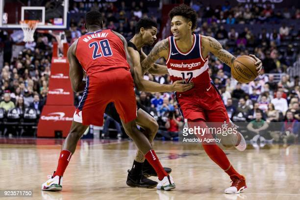 Washington Wizards Ian Mahinmi provides a pick for Kelly Oubre Jr against the Charlotte Hornets at the Capitol One Arena in Washington United States...