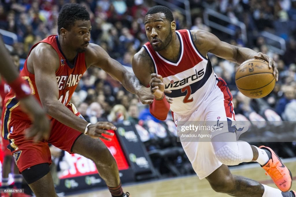 Washington Wizards' John Wall (2) tries to dribble past New Orleans Pelicans' Solomon Hill (44) at the Verizon Center in Washington, USA on February 4, 2017. The Wizards lead the Pelicans 53-49 at halftime and are trying to claim their 17th straight win at home.