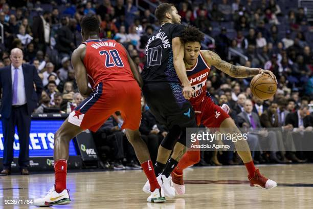 Washington Wizards Kelly Oubre Jr tries to get around Charlotte Hornets Michael CarterWilliams at the Capitol One Arena in Washington United States...