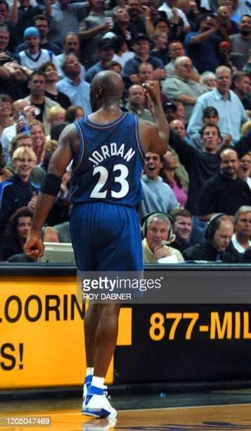 Washington Wizards Michael Jordan celebrates his gamewinning shot against the Phoenix Suns during the fourth quarter February 2002 in Phoenix AZ The...