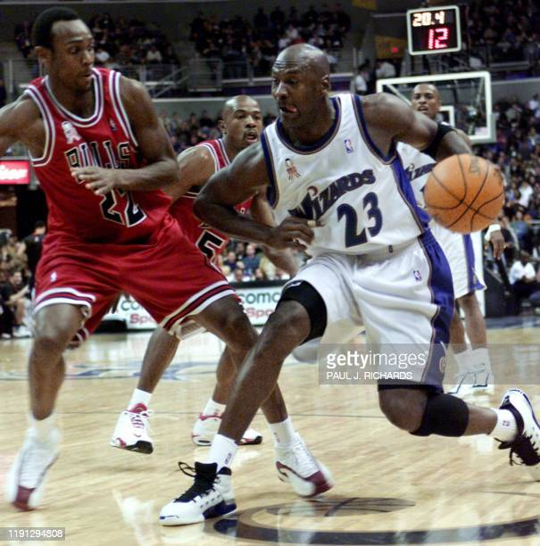 Washington Wizards Michael Jordan drives past Chicago Bulls Trenton Hassell en route to becoming the fourth player in history to shoot 30000 career...