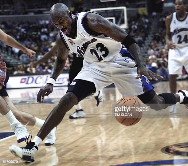 Washington Wizards Michael Jordan drives to the basket against the Utah Jazz at MCI Center 16 November 2001 in Washington, DC. Jordan had a season...