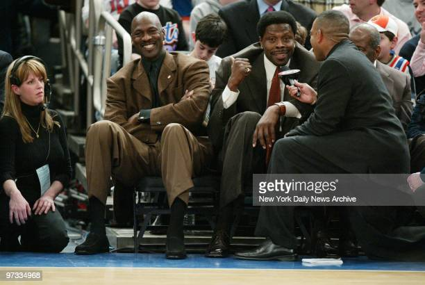 Washington Wizards' Michael Jordan laughs at a remark made by his pal former New York Knick Patrick Ewing during game between the Knicks and the...