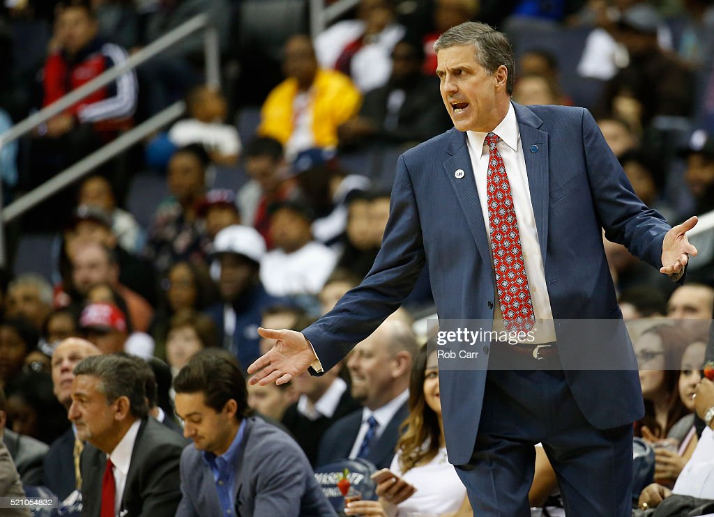 Washington Wizards owner Ted Leonsis, far left, looks on as head coach Randy Wittman (R) reacts to a first half play against the Atlanta Hawks at Verizon Center on April 13, 2016 in Washington, DC.