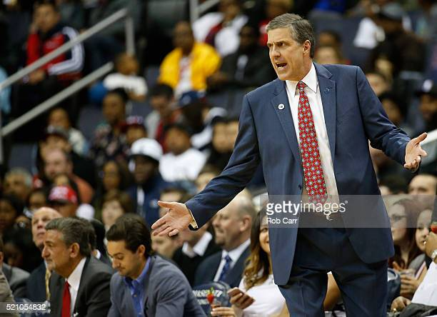 Washington Wizards owner Ted Leonsis far left looks on as head coach Randy Wittman reacts to a first half play against the Atlanta Hawks at Verizon...