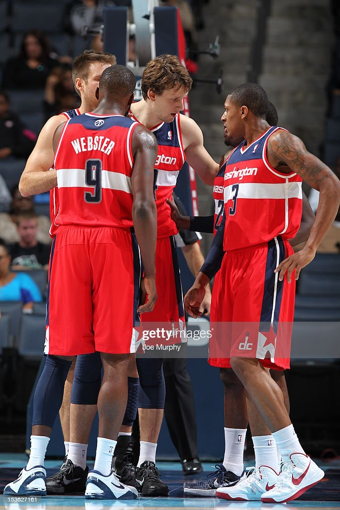 Washington Wizards players gather during the game between the Charlotte Bobcats and the Washington Wizards at the Time Warner Cable Arena on October 7, 2012 in Charlotte, North Carolina.